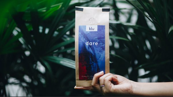 Dare packaging with plants in Background