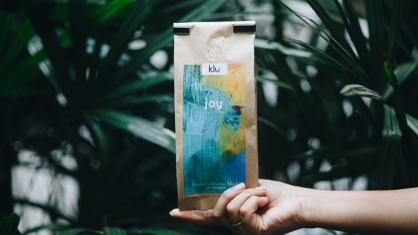 Joy packaging with plants in Background